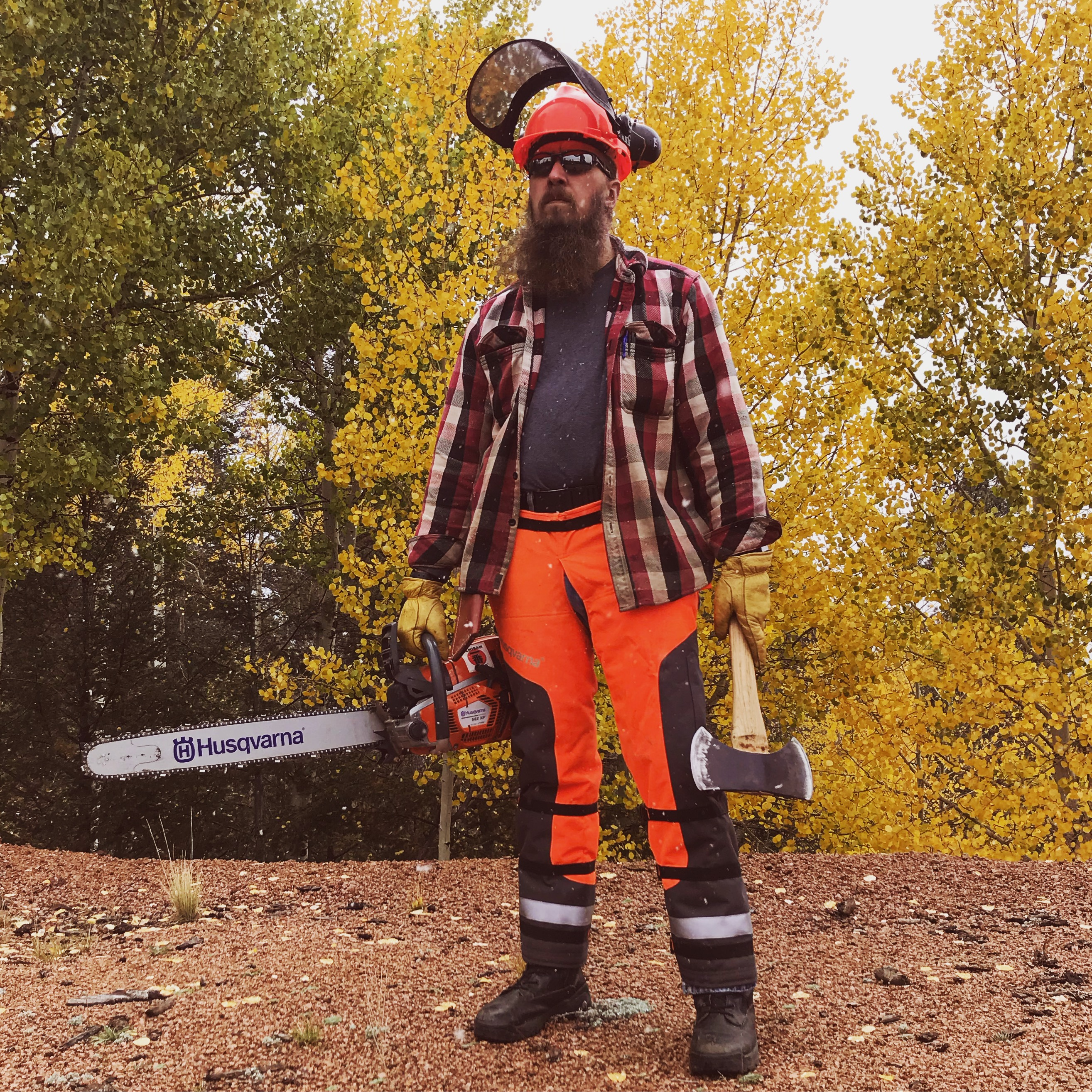 Mike with an axe and chainsaw