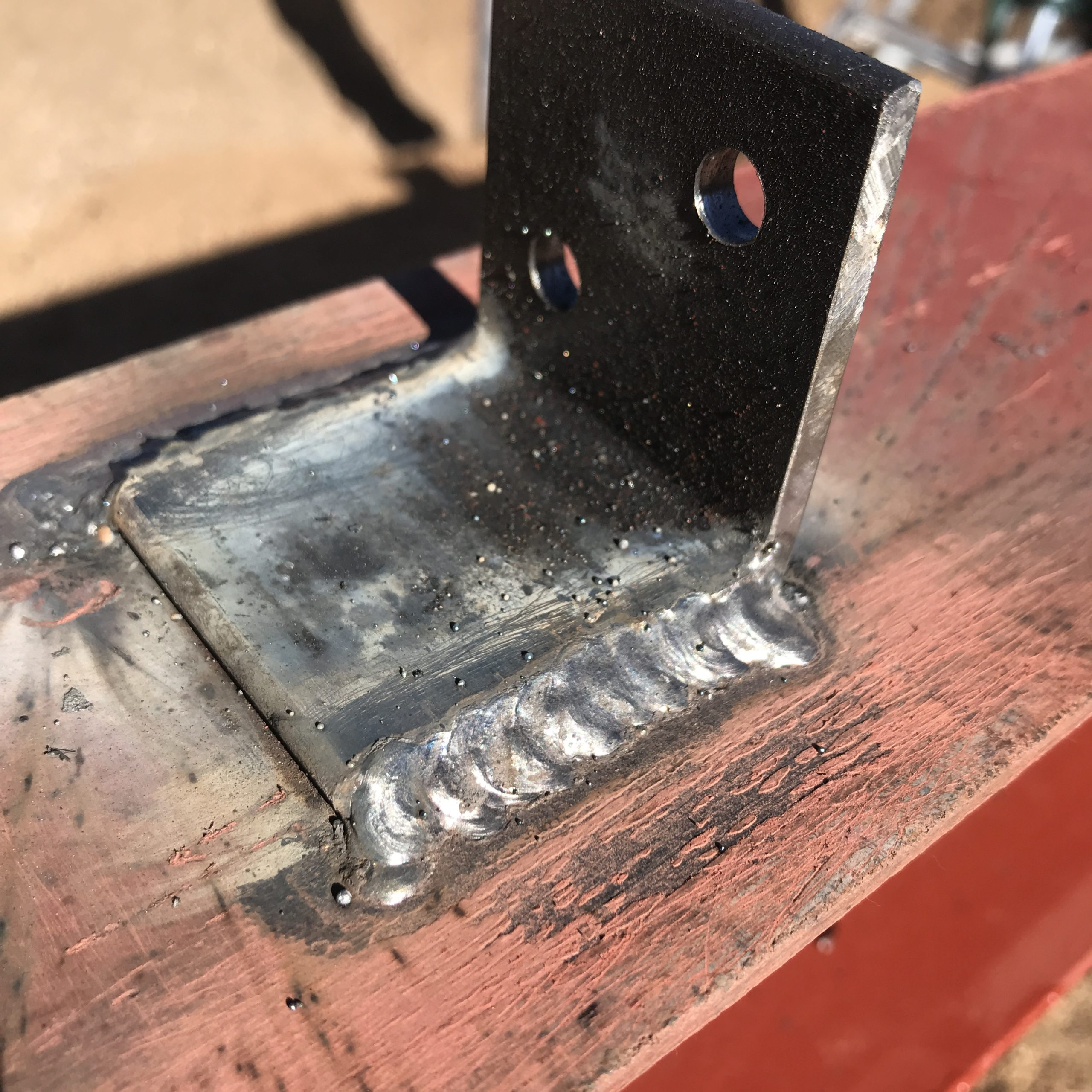 a manufactured clip welded to the beam for the arched cabin